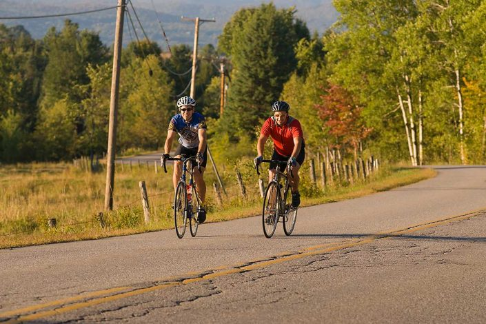 Two men road biking in Waitsfield, Vermont.