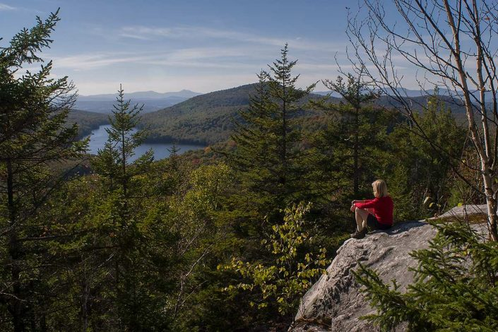 Woman atop Owl's Head Mtn., Groton State Forest, Groton, Vermont