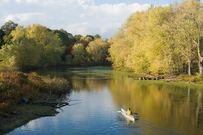 A man in a kayak on the Concord River in Concord, Ma.